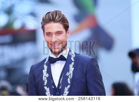 Andrea Dal Corso walks the red carpet ahead of the 'One Nation One King (Un Peuple Et Son Roi)' screening during the 75th Venice Film Festival at Sala Grande on September 7, 2018 in Venice, Italy.