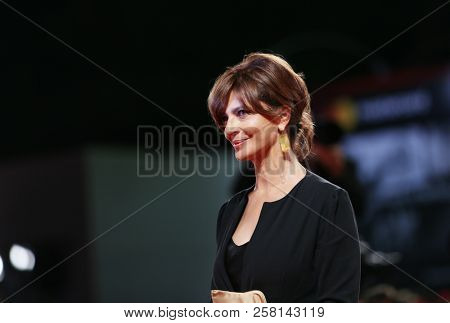 Laura Morante walks the red carpet ahead of the 'Una Storia Senza Nome' screening during the 75th Venice Film Festival at Sala Grande on September 7, 2018 in Venice, Italy.