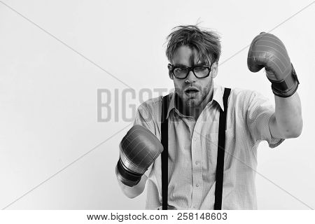 Man With Bristle And Dull Face Wears Boxing Gloves