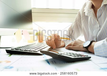 Businesswoman Investment Consultant Analyzing Company Annual Financial Report Balance Sheet Statemen