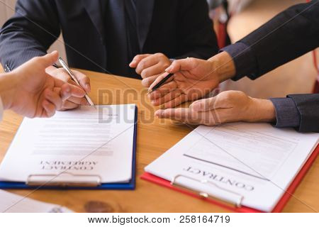 Co-investment Business Signing Contract Agreement After Successful Deal. Business Contract And Meeti