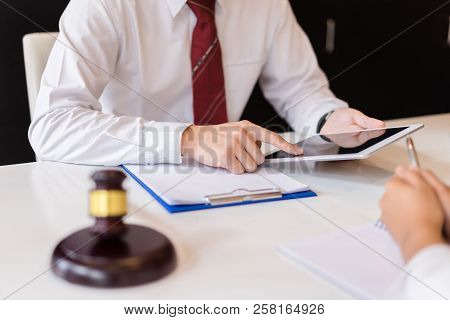 Consultation Between A Male Lawyer And Business People Customer About Legislation And Regulation.