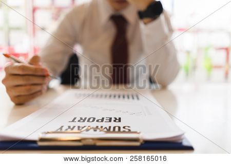 Depressed Businessman Feeling Stressed When Readed The Business Report.