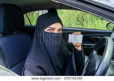 Saudi Woman Driving A Car On The Road And Showing A Blank Driving Licence For Graphic Montage. Musli