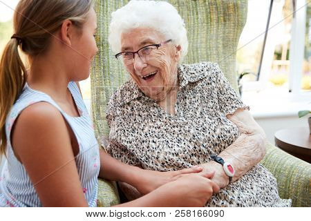 Granddaughter Visiting Grandmother In Lounge Of Retirement Home poster