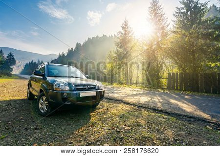 Mizhhirya, Ukraine - Oct 21, 2017: Hyundai Tucson Suv On Countryside Road In Foggy Mountains. Lovely
