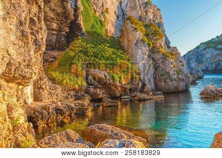Mediterranean Sea Cliffs at Cales Coves at Sunset, Menorca Island, Spain.