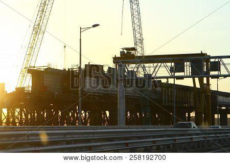 Russia, Crimea Bridge - May 26, 2018: Construction Of Railroad Part Of Crimea Bridge On Sunset Time,