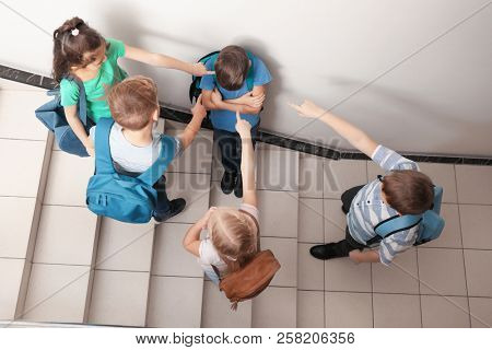 Little children bullying their classmate indoors