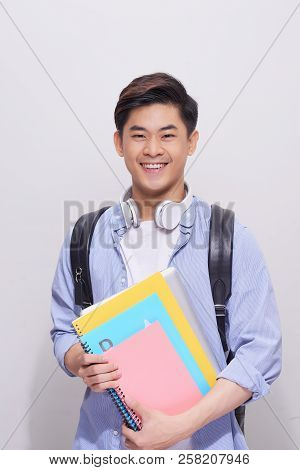 Confident Asian Handsome Student Holding Book. Confident Asian Handsome Student Holding Book Gesture