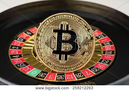 Gold Physical Bitcoin Coin On Casino Roulette. Crypto Currency Market Gambling Abstract Concept.