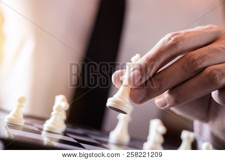 Hand Of Confident Businessman Use King Chess Piece White Playing Chess Game To Development Analysis