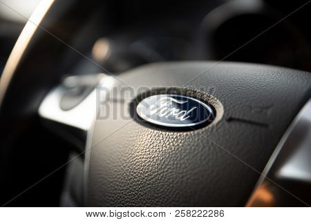 Wroclaw, Poland - Jul 21, 2018: Ford Sign On Steering Wheel Close Up. Ford Is The Most Popular Car O