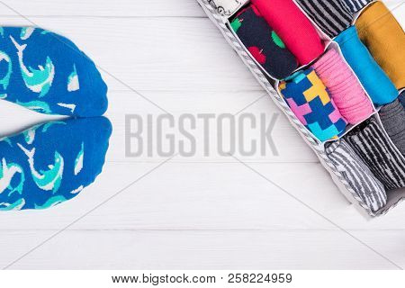 Box With Colorful Socks. Feet Selfie And A Socks Organizer On A White Background. Top View, Free Spa