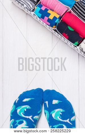 Feet Selfie And A Socks Organizer On A White Background. Top View, Free Space