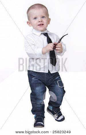 Cute boy standing with smoking pipe