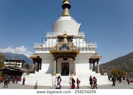 Thimphu, Bhutan - March 14, 2012: Buddhists Circling Clockwise The National Memorial Chorten While R