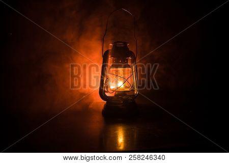Oil Lamp Lighting Up The Darkness Or Burning Kerosene Lamp Background, Concept Lighting. Selective F