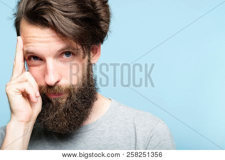 Intelligence And Smart Ideas Concept. Mind Games And Brain Power. Smug Confident Bearded Man Portrai