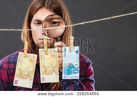 Currency Exchange Concept. Man Worker Check Verify Money Cash. Payment Hang On Laundry Line. Guy Wit
