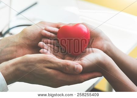 Doctor Hands Holding And Giving Red Massage Heart To Patient Little Children For Recover From Sickne