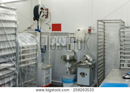 Food processing plant storage room with rack trolleys and hand washing area