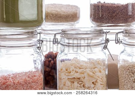 Glass Food Storage Jars. Close-up Of Recipe Ingredients In Kitchen Containers. Airtight Jars With Dr