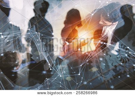 Handshaking Business Person In Office. Concept Of Teamwork And Partnership. Double Exposure With Gea