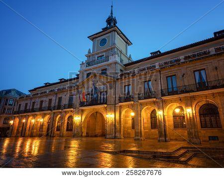 Illuminated Townhall Of Oviedo With Blue Sky At Daybreak, Spain