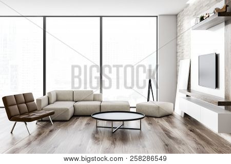 Interior Of Loft Living Room With Wooden Floor, White And Wooden Walls, A Sofa And A Leather Bench.