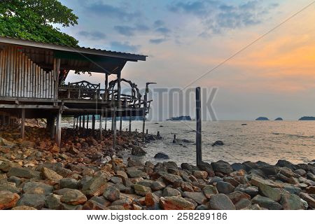 Cheap bungalows for backpackers on a tropical beach in sunset time. Thailand
