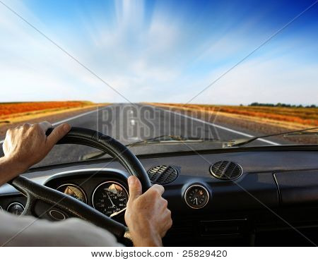 Driver's hands on a steering wheel