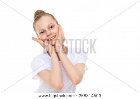 Emotional Little Girl In A Clean White T-shirt. The Concept Can Be Used To Advertise Goods And Servi