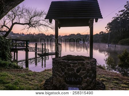 Wishing Well Overlooking Kerikeri Inlet With Morning Mist Over Water. Photographed At Dawn At Korori