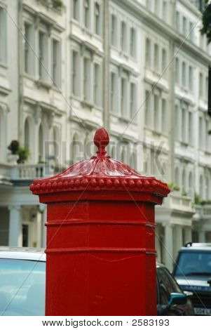 Traditional English mailbox and row houses in London poster