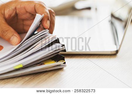 Businessman Hands Holding Pen For Working In Stacks Of Paper Files Searching Information Business Re