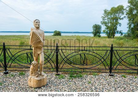 Wooden Sculpture Of A Musician Playing The Accordion On The Galichsky Lake Embankment September 11,