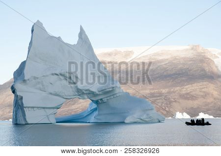 Giant Iceberg With Inflatable Zodiac Boat - Greenland
