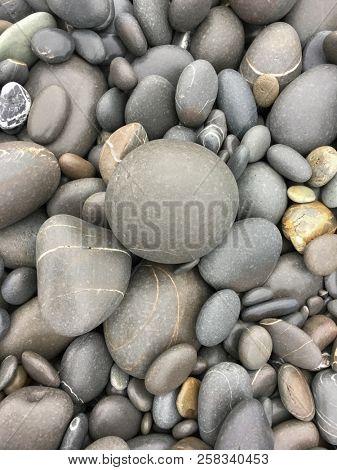 Sea pebble sea stones background beach rocks.