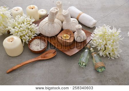 Spa setting with candle, salt, in bowl ,soap with Bouquet of hydrangea ,oil,towel, on gray background