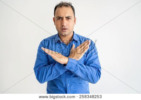 Serious Man Showing Crossed Hands And Looking At Camera. Indian Guy Denying Something. Prohibition C