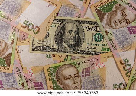 One Hundred Dollar Bill On The Background Of Ukrainian Five Hundred Hryvnia Banknotes