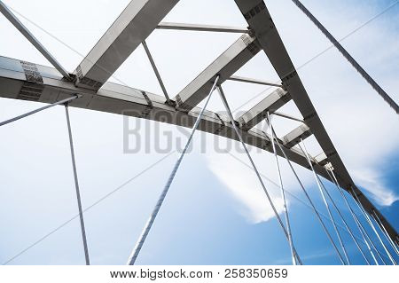 White Steel Cable-stayed Bridge Fragment Under Blue Cloudy Sky. Keelung, Taiwan