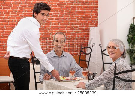 Elderly couple dining