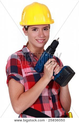 Pretty girl holding an electrical screwdriver