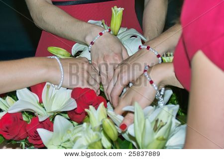 Hands in Wedding Flowers