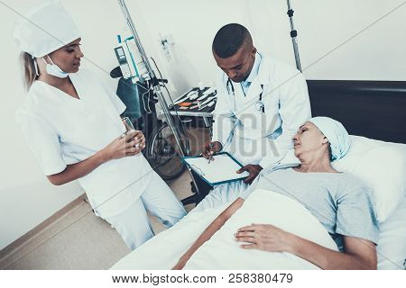 Nurse With Glass Of Water. Sitting Doctor. Clinic. Cancer Patient. Woman On Bunk. Cancer Patient. Do