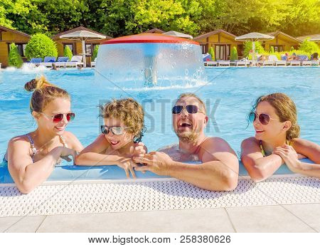 Happy Family In The Pool, Having Fun In The Water, Dad With Three Kids Enjoying Aqua Park, Beach Res