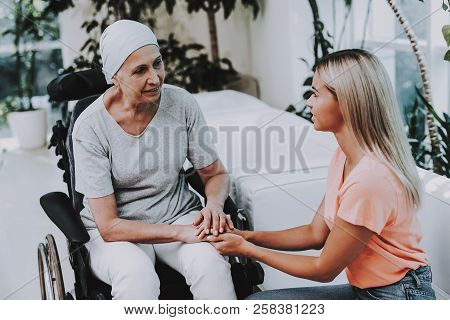 Patient Undergoes Rehabilitation. After Treatment For Cancer. Cancer Patient On A Wheelchair. A Woma