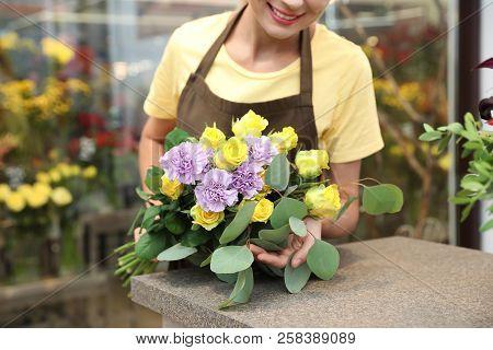 Female Florist Making Beautiful Bouquet In Flower Shop, Closeup